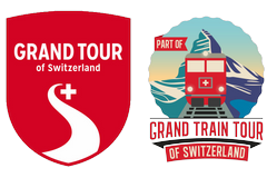 Лого Grand Tour of Switzerland и Grand Train Tour of Switzerland.